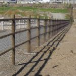Pole wood fence with link